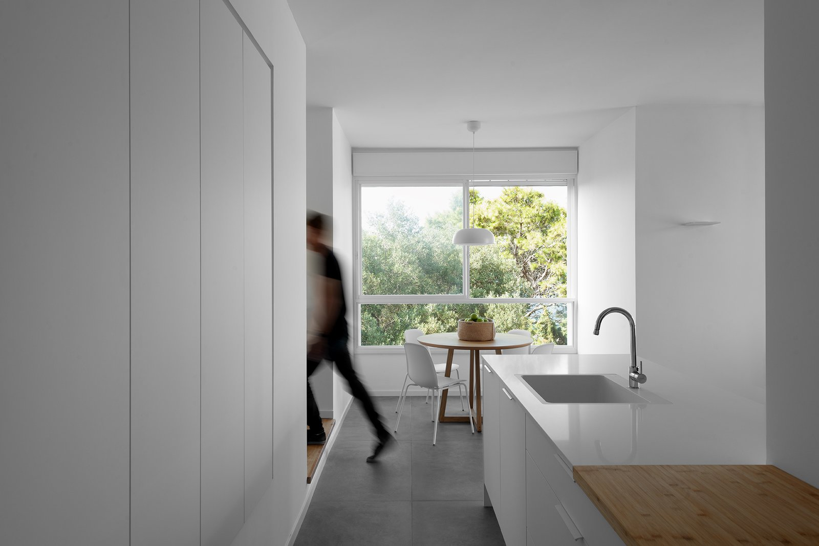 Apartment in Haifa by Michael Peled Architecture Studio white kitchen and dining