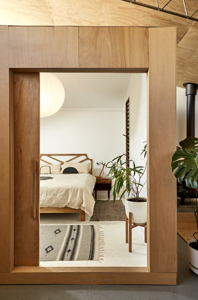 Since the warehouse is laid out as an on-grade slab with no basement, the bedroom is raised on an insulated base to add greater warmth in the winter.