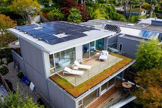 The solar photovoltaic rooftop panels draw 12 kilowatts of electricity. The prefabricated cross-laminated timber structure is insulated by 17-inch walls, and the deck outside the master bedroom is bordered with sedum.