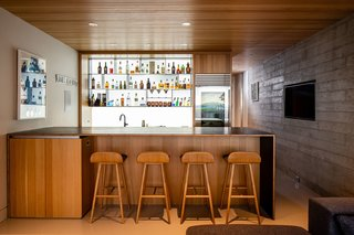 A fully stocked bar is located in the basement, along with a wine cellar.