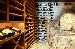 Rock penetrates the building envelope in the wine cave, providing a naturally cool temperature. Pegs inserted in the foundation add storage capacity.