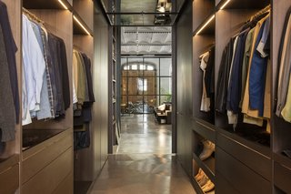 An extensive walk-in closet is a pass-through between the living space and the master bedroom.