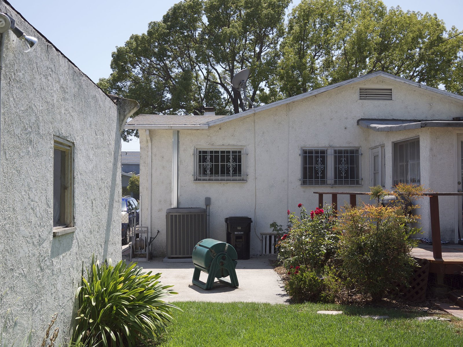 Exterior, Stucco Siding Material, House Building Type, and Hipped RoofLine Replacement of the garage and dining room created view corridors and a kind of courtyard between the renovated dwelling and the new guesthouse.   Photo 16 of 19 in Before & After: A Los Angeles Bungalow Opens to a Gorgeous Garden Oasis