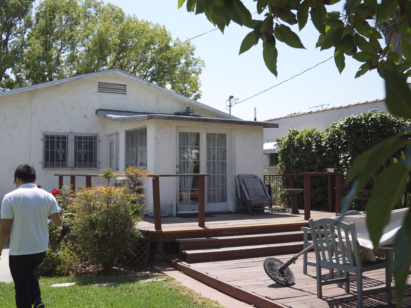 Outdoor, Back Yard, Decking Patio, Porch, Deck, and Wood Patio, Porch, Deck The laundry room previously occupied the back of the house, and was extended to become the main bedroom.   Photo 9 of 19 in Before & After: A Los Angeles Bungalow Opens to a Gorgeous Garden Oasis