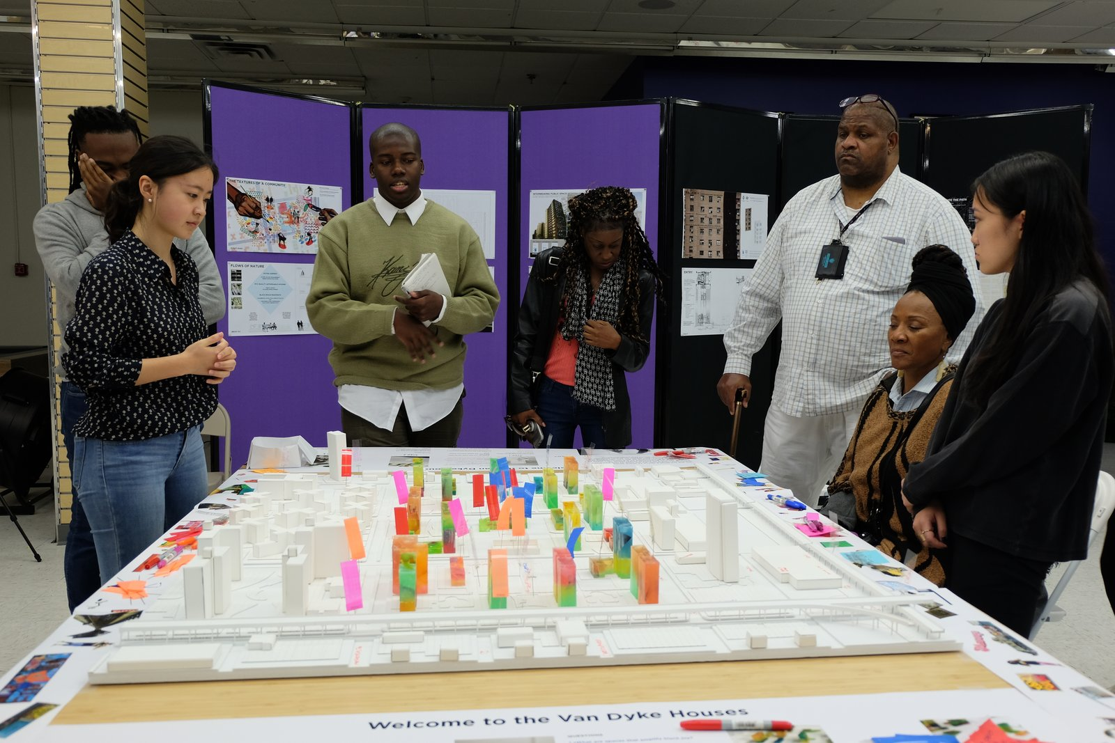 BlackSpace members Peter Robinson and Ifeoma Ebo use an interactive model for a workshop at Van Dyke Houses in Brownsville, Brooklyn.  Photo 6 of 6 in How Blockbusting and Real Estate Profiteers Cash In on Racial Tension