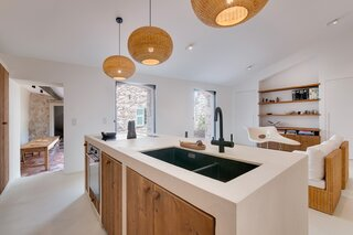 Bierman designed the custom wood and resin kitchen cabinetry with a carpenter.