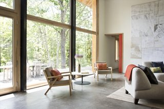 An abundance of south-facing windows connect the double-height living room to the outdoors.