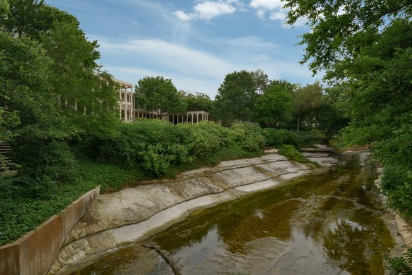 The view from the bridge over Bachman Creek, with the home's pool house on the opposite bank.