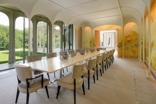 The dining room, reminiscent of the Glass House at New Canaan,  features the work of Matthew Ritchey.