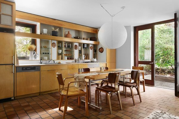 The kitchen's shelving and cabinetry was a product of an early 1990s renovation, still featuring ceramic masks the Merzes purchased in Mexico.