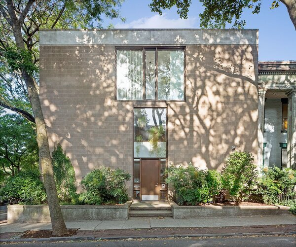 The corner house's most prominent feature is a keyhole window that resembles Louis Kahn's Esherick House.