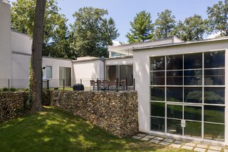 Original stone walls and landscaping grace the Harrison House.