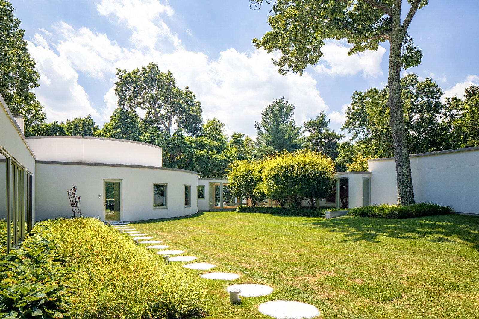 Exterior, Concrete Siding Material, House Building Type, and Flat RoofLine The Harrison House surrounds a green courtyard on three sides.  Photo 2 of 10 in After a Herculean Renovation, Architect Wallace Harrison's Landmarked Home Seeks a New Caretaker