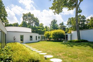 The Harrison House surrounds a green courtyard on three sides.