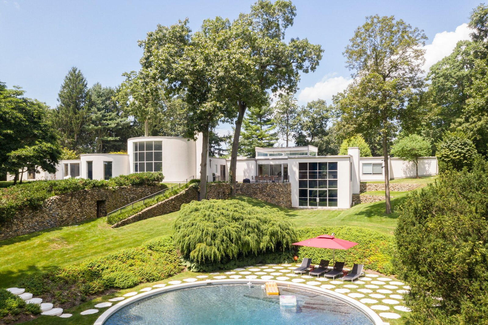 Exterior, Concrete Siding Material, Flat RoofLine, and House Building Type Once headed for demolition, the storied Long Island residence by the Rockefeller Center designer is on the market for $5,999,000.  Photo 1 of 10 in After a Herculean Renovation, Architect Wallace Harrison's Landmarked Home Seeks a New Caretaker