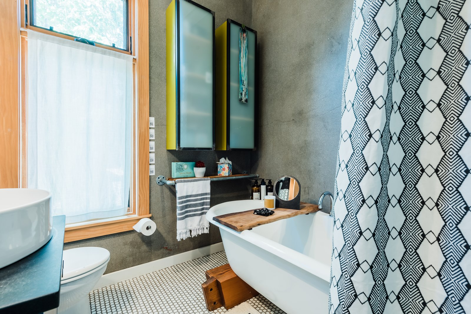 Bath Room, Soaking Tub, Freestanding Tub, Pedestal Sink, and Drop In Sink Quaint bathroom with a clawfoot tub at The Sursy GandyHouse.  Meet The Makers: ARCHITECT / Nicole Delmage, ShelterBelt Designs (Denver, CO) SHOWER CURTAIN / Tressa Lavinia Linzy Designs (Fernandina Beach, FL) WALNUT BATH TRAY / Protea & Pine (Denver, CO) CANDLE / North + 29 Candle Co (Castle Rock, CO) ROCKY MOUNTAIN MIRROR / soft co. (Philadelphia, PA) PAPER PRODUCTS / Who Gives A Crap (Melbourne, Victoria) MUDCLOTH COASTERS / Reflektion Design (Los Angeles, CA)  The Sursy GandyHouse by The Sursy