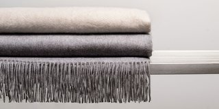These cashmere throws, among the new offerings from Ben Soleimani, are available in three designs.
