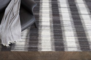 Kata rug is a flatwoven ikat realized in soft-spun wool.