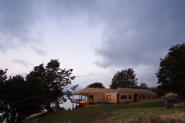 In wild, rugged Patagonia, Chilean architectural firm SAA Arquitectura + Territorio has crafted a comfortable and contemporary home in a notoriously inhospitable environment where access to materials and labor is limited. The exterior is entirely sheathed in shingles made from locally sourced lenga wood, a species native to the Patagonia-Andean forests.