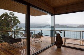 Large decks and walls of glass blur the boundaries between indoor/outdoor living.