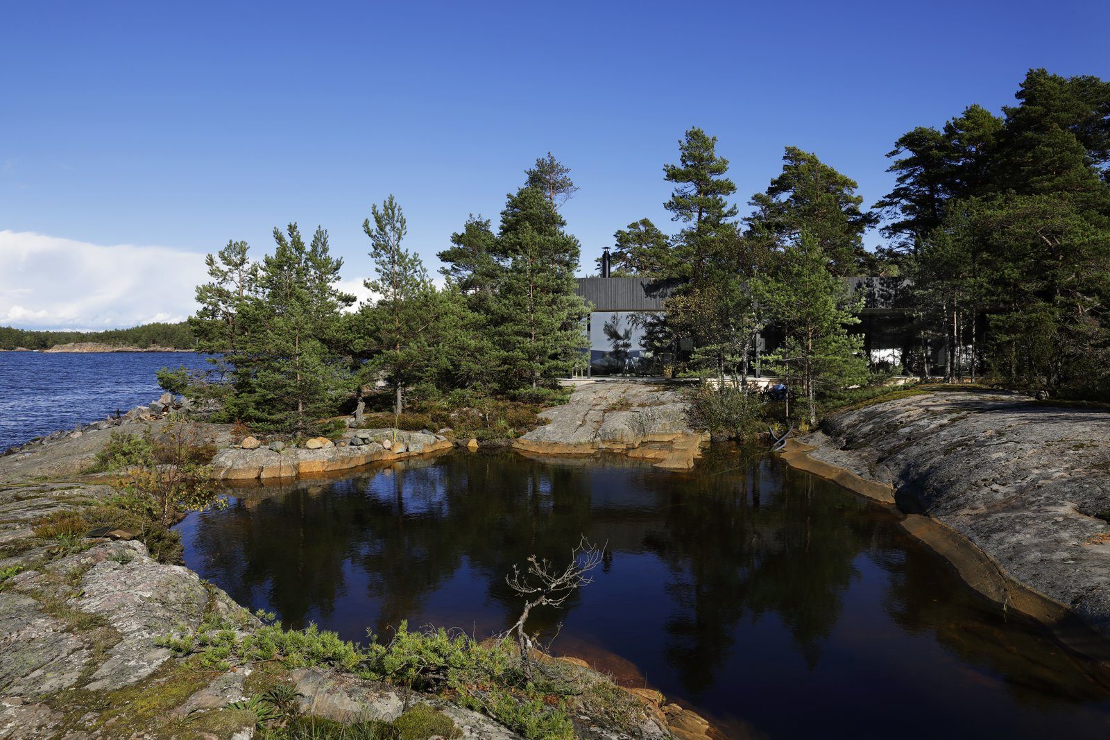 Villa Kivi on a tiny island by Vertti Kivi
