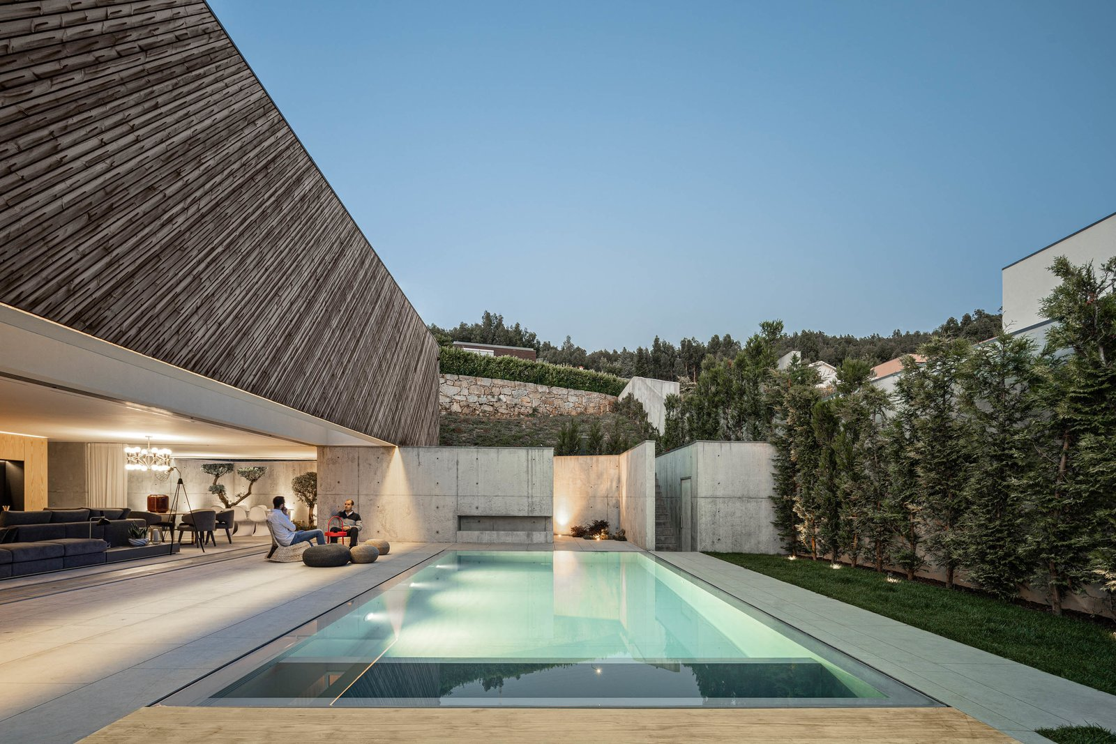 Outdoor Indoor/outdoor living is sweet at Casa A by REM'A Arquitectos: residents can easily step from the sleek concrete interiors to enjoy the pool and backyard area, which are framed by hillside views.  Best Outdoor Photos from Casa A