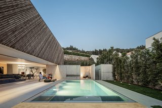 Indoor/outdoor living is sweet at Casa A by REM'A Arquitectos: residents can easily step from the sleek concrete interiors to enjoy the pool and backyard area, which are framed by hillside views.