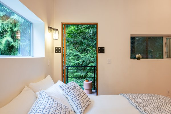 Steps from the bed is a private balcony, providing a cozy spot to soak up the tranquil setting.