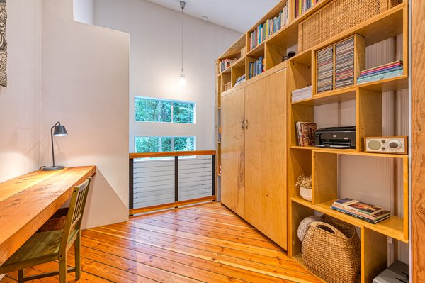On the other side of the open loft is a quiet yet spacious office with custom birch storage.