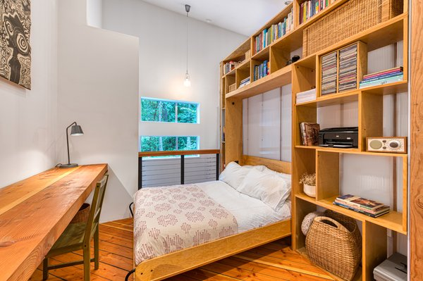 A built-in Murphy bed easily converts the office into a private guest room.
