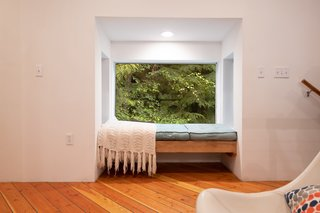 A pop-out nook on the second floor provides a cozy place to curl up with a book.