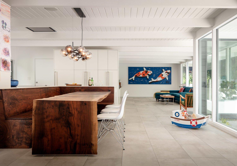 Living Room, Bench, Chair, Ceiling Lighting, Porcelain Tile Floor, and Pendant Lighting Communal area  The Leichler