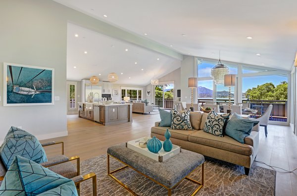 The heart of the house is an enormous great room that offers sweeping 180-degree views that extend from Mt. Tam, to Richardson Bay, to the hills of Tiburon, and the Belvedere Lagoon