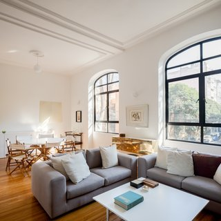 The interiors of the historic home were completely restored and updated with a modern white color scheme.
