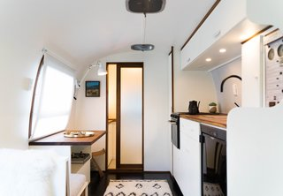 """I wanted it to feel like an old Airstream, just with a refreshed new face. So I decided to start with white and have only one wood tone, walnut,"" says August."