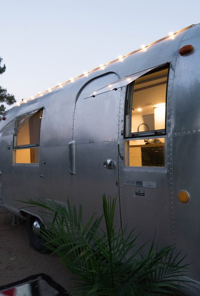The trailer's original exterior boasts the hard-earned patina of decades spent on the road.