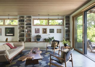 The great room features a sound-dampening ceiling made of strips of Douglas fir laid over recycled denim insulation.