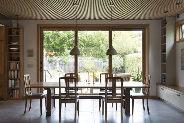 The triple sliding doors enable an indoor/outdoor lifestyle during good weather. Though they weren't cheap, it's a splurge the family doesn't regret. The dining room table was built by John Paluska's father, a furniture maker in Maine.