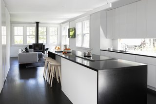 Messana O'Rorke combined the existing kitchen, living, and dining rooms into a single open space, and bumped out the rear wall behind the kitchen to provide additional footprint.