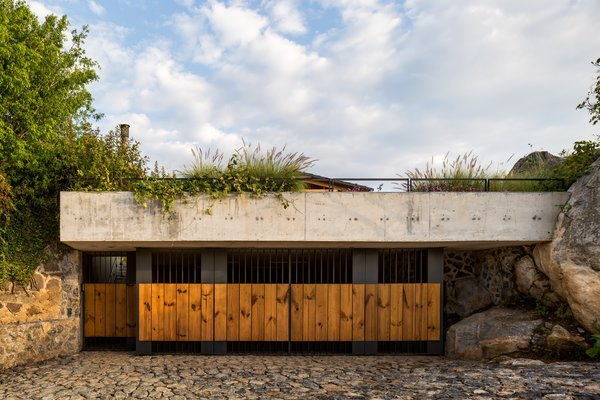 The garage at CMV House makes use of a wide range of materials: wood, metal, concrete, and stone.
