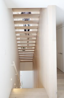 Riserless stairways connect the home's three levels while allowing light to filter down below.