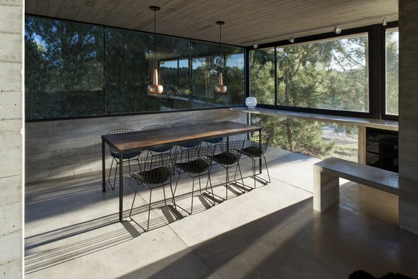 The home's interior is quite minimal and makes extensive use of large windows to let in sunlight and views.