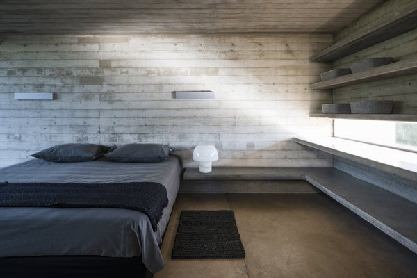 A sparse bedroom on the home's second floor.