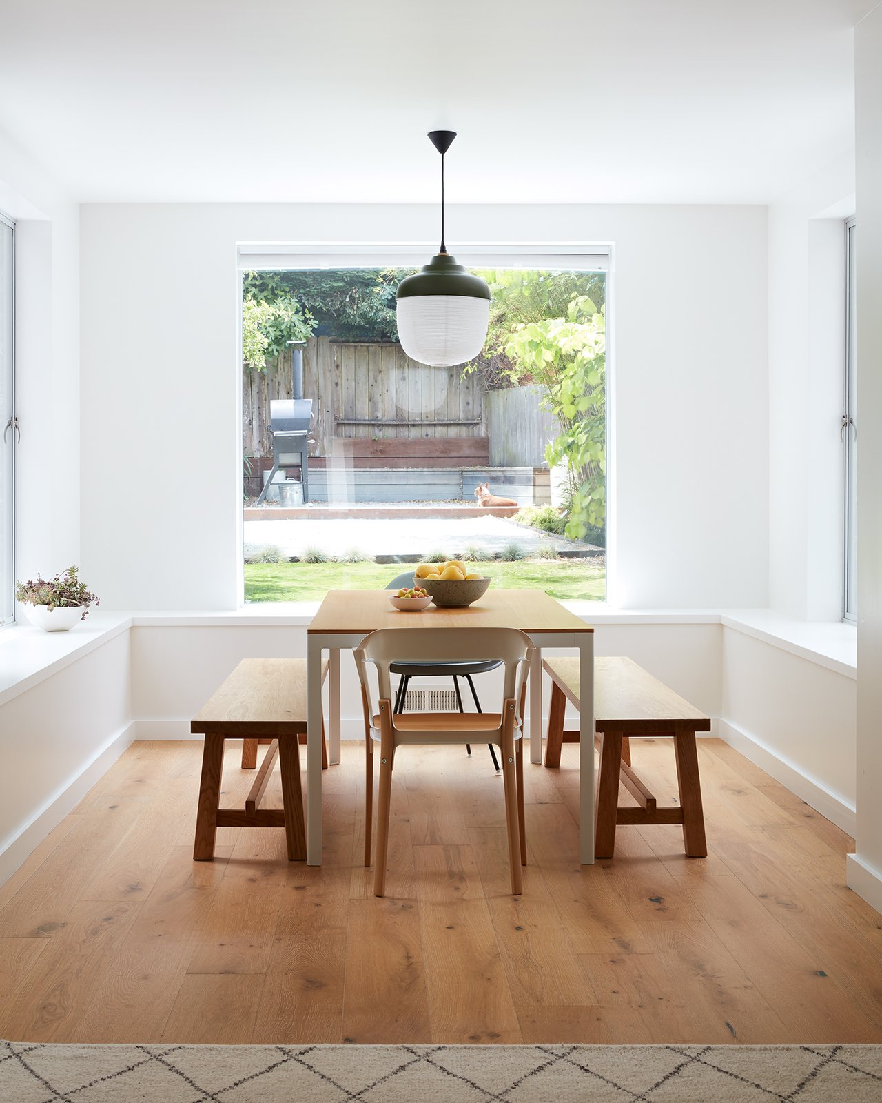 View of Dining Area to Backyard: The New Old Light by Kimu Design hangs in the foreground.