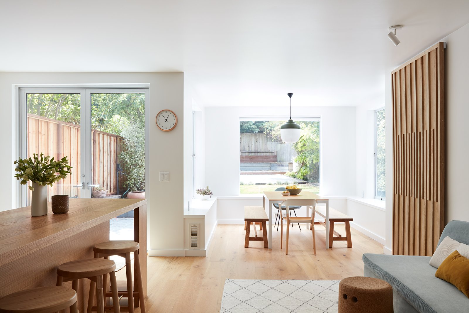 The Living Space: Custom kitchen island and sliding doors were designed to reflect the family's Asian American background.