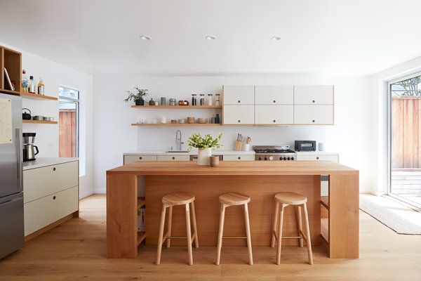 Kitchen Space: The kitchen island design is inspired by Donald Judd's Library Table and was built with the flexibility of removing the cabinet storage to convert it to a counter-height table.
