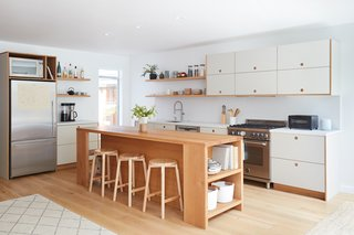 This lovely kitchen features laminate cabinets by Danish brand Reform.