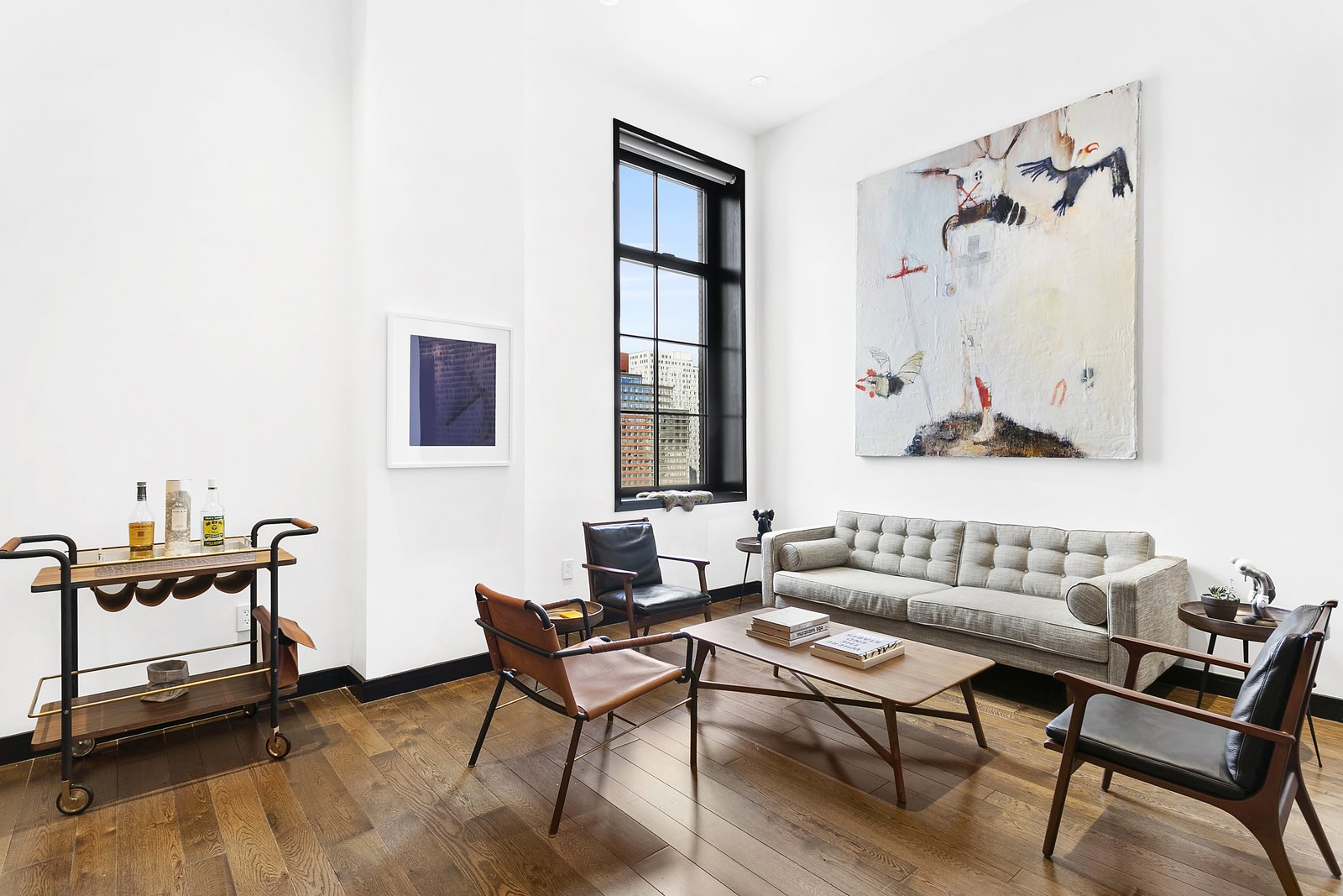 Living Room, Chair, End Tables, Coffee Tables, Medium Hardwood Floor, and Sofa Beautifully designed with many Danish inspired pieces, the unit can be delivered fully furnished.   Expansive Pre-War Architecture Meets Stylish and Modern Living