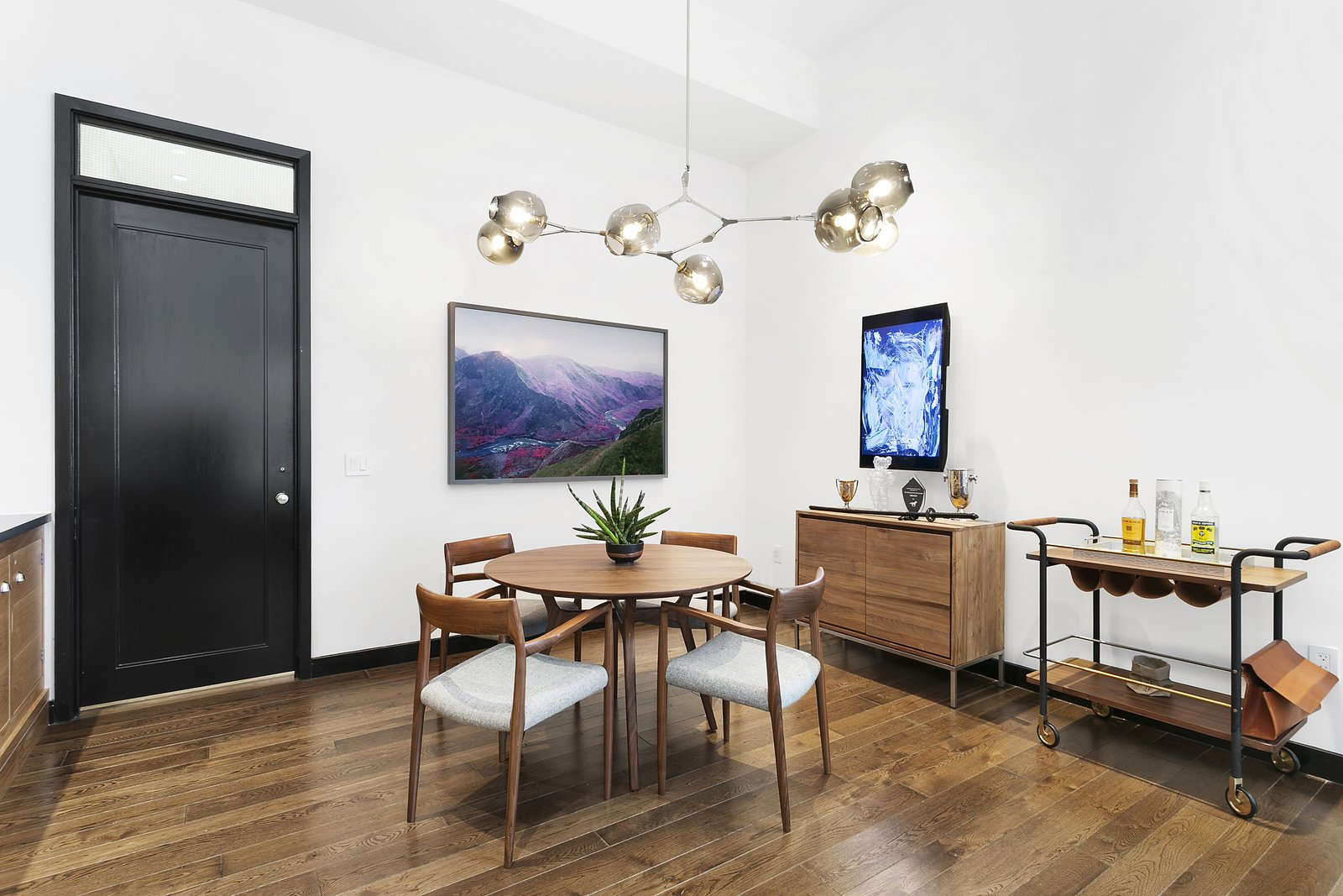 Dining Room, Table, Medium Hardwood Floor, Ceiling Lighting, Storage, Chair, and Bar 11J contains all of the necessary amenities for every day cooking as well as entertaining. Shown here is the beautiful dining area.  Expansive Pre-War Architecture Meets Stylish and Modern Living