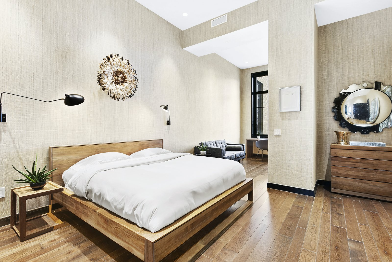Bedroom, Night Stands, Bed, Dresser, Medium Hardwood Floor, and Wall Lighting The generous master suite contains an alcove perfect for a home office, entertainment space or nursery.   Expansive Pre-War Architecture Meets Stylish and Modern Living